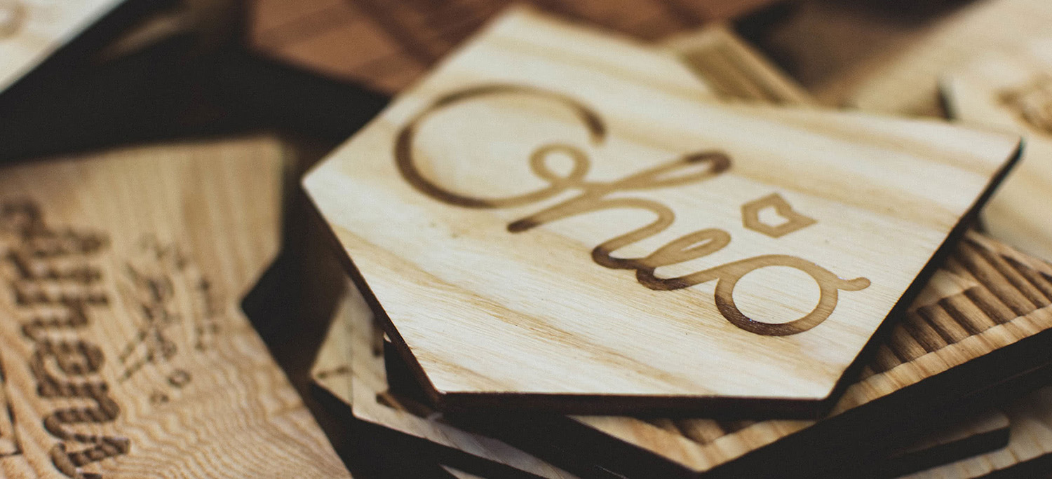 Red Tail Design promotional materials project page header featuring Ohio wood coaster.