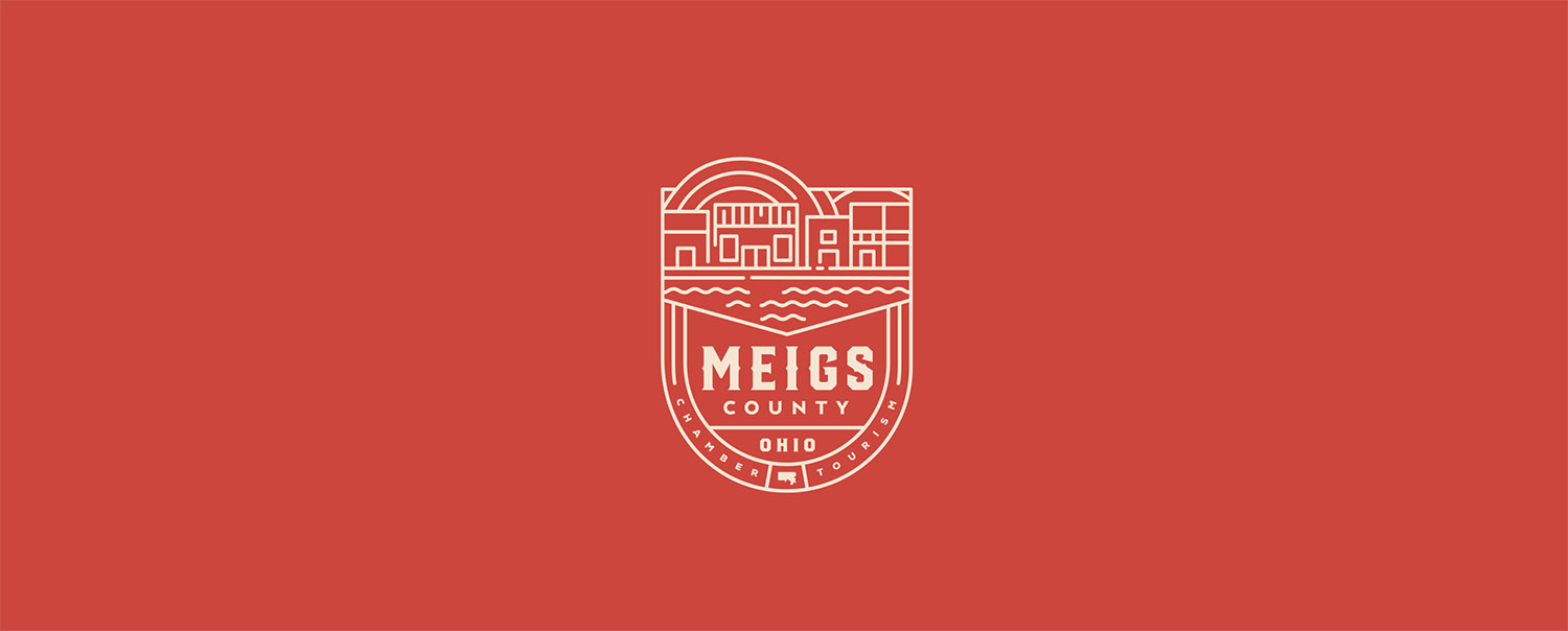 Meigs County Chamber and Tourism emblem, white on red, header image for project entry in Red Tail Design portfolio.