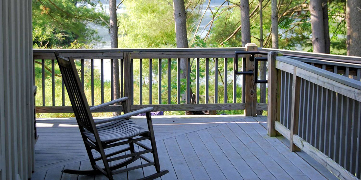 Front Porch Project homepage slider image as portfolio project header featuring rocking chair on porch.